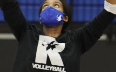 Positioning herself under the ball, Phoenix Bailey, 12, winds up for a spike at volleyball practice. Photo Credit: Kate Benninghoff