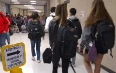 Students venture out into divided hallways, bustling to their next class in time before the bell.