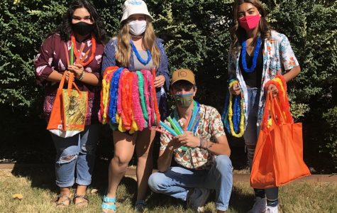 """Emilia Aguayo, 11, Hannah Pace, 11, Bryce Newton, 12, and Virginia Romero, 9 show their school spirit by participating in Spirit Week's """"Florida Monday."""""""