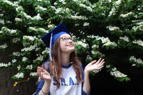 Lizzy Kaufman, 12, is looking forward to a COVID-friendly graduation.