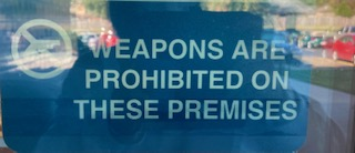 The anti-weapon sign outside of the science hallway.